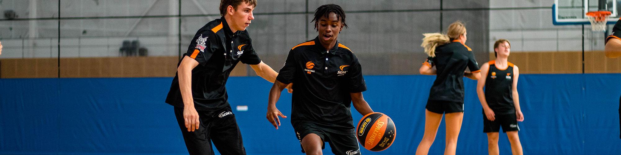 SEDA Basketball WA students playing basketball on courts
